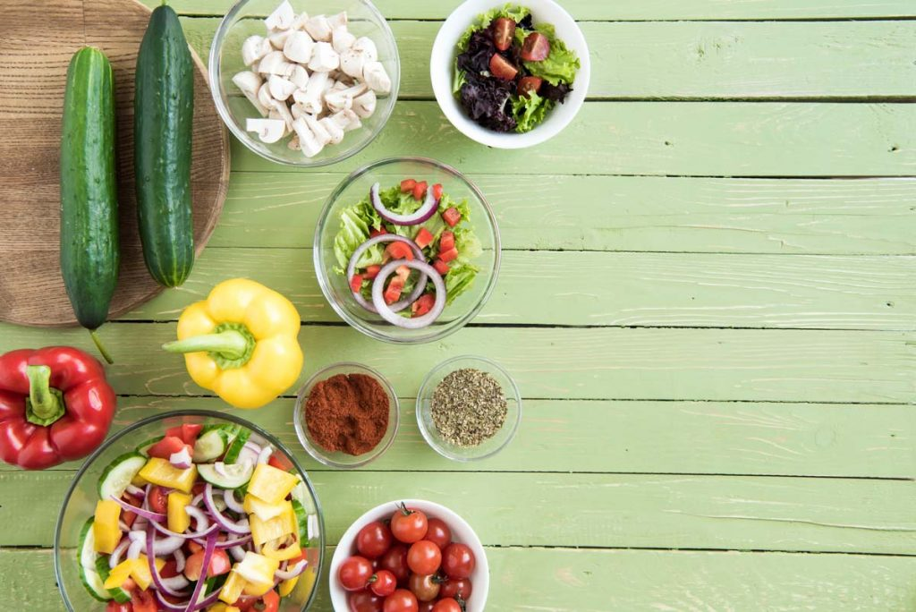 Vegetables on green wooden table